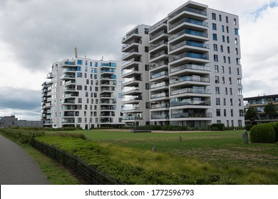 Temse, Belgium, July 05, 2020, Two residential apartments and a towpath in the Belgian municipality of Temse