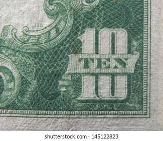 Ten 10 dollars US Currency close up macro of number ten on ten dollar bill