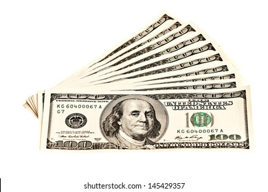 Ten 100 dollar banknotes isolated on white