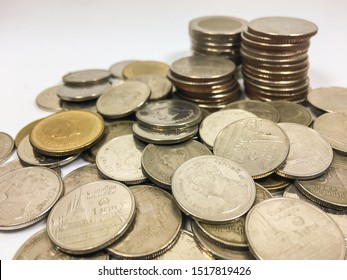 Ten baht, five baht, One baht Coin and Coin stacks on a white background