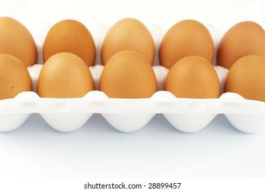 ten brown eggs in white package