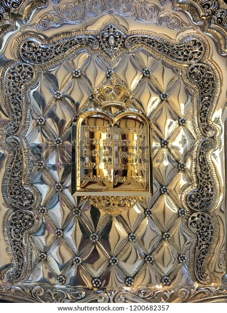 The Ten Commandment on a silver shield of a Torah Book. Jewish religion background and texture