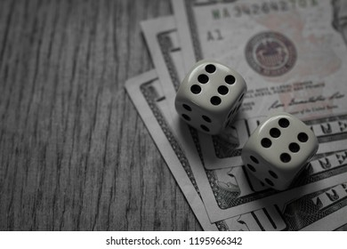 Ten Dollar Bills and game dice with copyspace