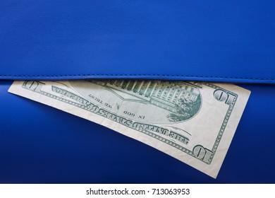 ten dollar in light blue leather wallet