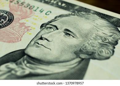 Ten dollars bill fragment of U.S. money. Macro photo.