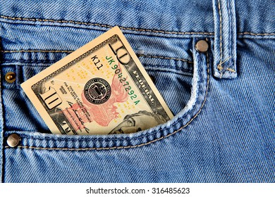Ten Dollars in the Pocket of the Jeans closeup