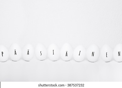 ten easter eggs in a row with text easter in finnish