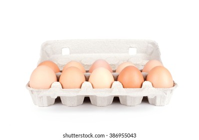 Ten eggs in a carton package isolated on white