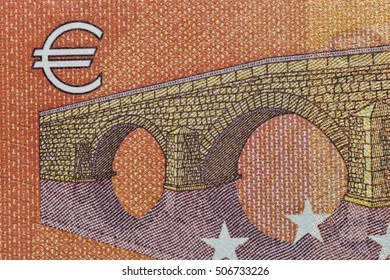 Ten Euro banknote fragment with Euro symbol closeup, back side