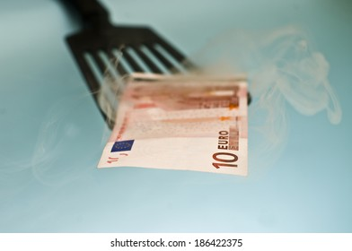 Ten euro bill coming out from the bank oven