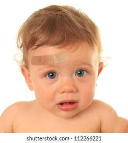 Ten month old baby boy with band aid.