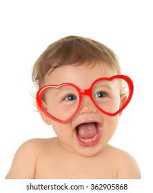 Ten month old baby boy wearing heart shape valentine glasses.
