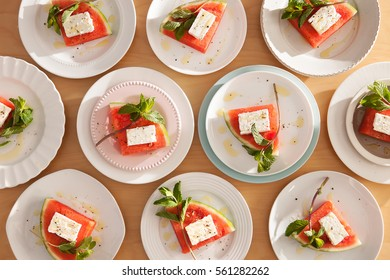 Ten plates of Sliced Watermelon with Feta and Mint Salad