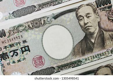 Ten thousand yen bills and textures