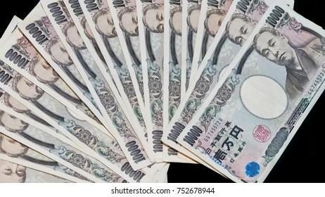Ten thousands japanese yen bills, the currency bills. japan money on black background
