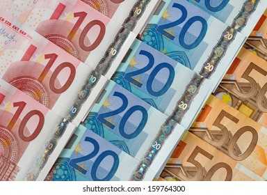 Ten, twenty and fifty euro notes diagonal rows.