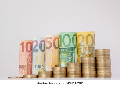 Ten, twenty, fifty, one hundred, two hundred and coins euro rolled bills banknotes on white background. Histogram from the euro. Concept of currency growth, savings
