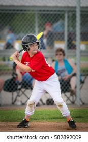 ten year old boy getting ready to swing the bat