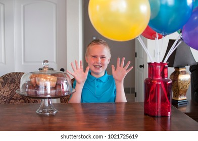Ten Year Old Celebrates With Cupcakes and Balloons