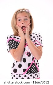 Ten year old female girl in pink surprised isolated against a white background with copy space in the vertical format.