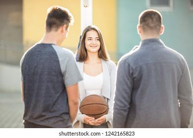 Tenage girl with basketball ball