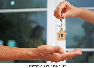 Tenants are taking home keys from the landlord.