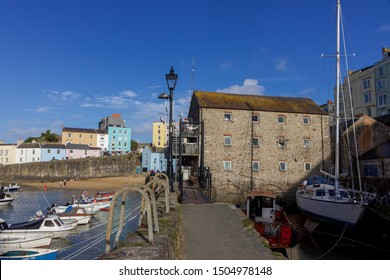 Tenby, Pembrokeshire, Wales - 17 August 2019: View of Colourful Houses and Old Town Houses in Tenby Harbour