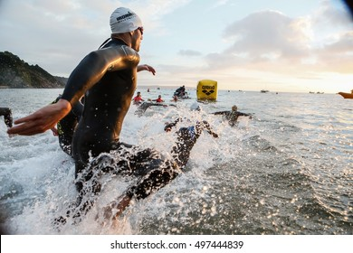 Tenby, Pembrokeshire, Wales, UK. September 11 2016 Ironman Wales 2106, Triathletes entering the sea off North Beach Tenby to start Ironman Wales