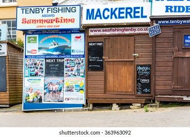 TENBY, WALES- 3 NOV 2015: Huts for booking fishing trips on the Harbour at Tenby.