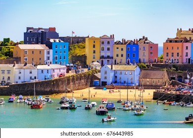 TENBY, WALES - June 18th 2017: Beautiful summer sunshine and warm weather drew visitors to the beach Tenby, Wales.