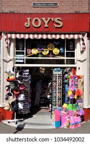 TENBY, WALES, UK - JULY 6, 2017. A small seaside shop on Upper Frog Street at Tenby, an ancient walled coastal town, now a tourist destination in south Wales, UK.