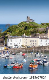 Tenby, Wales, UK , May 14, 2018 : Tenby Harbour which is a popular seaside resort town in Pembrokeshire and a popular travel destination tourist attraction landmark, stock photo image