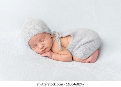 Tender newborn sleeping on belly