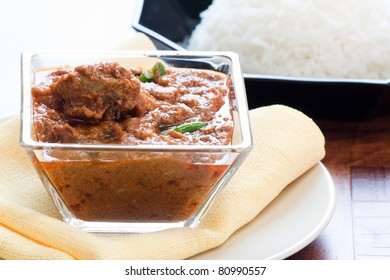 Tender pieces of marinated lamb cooked in traditional Indian spices. Served with steamed rice.