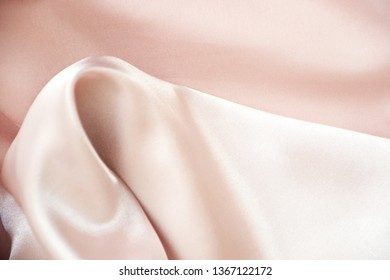 Tender pink pastel textile background with copy space. Pink fabric textures background, fabric uneven. Abstract blur of pink fabric for Wedding background. Pink silk fabric defocused for background.