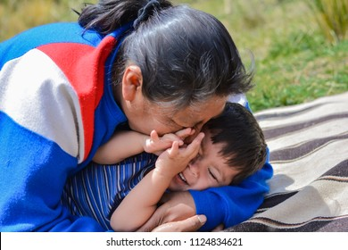 Tender portrait of native american woman with her little son in the countryside.
