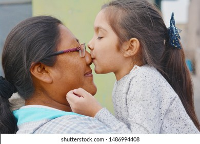 Tender portrait of native american woman with her little daughter.