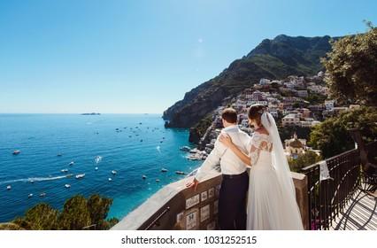 Tender romantic young couple in honeymoon in Positano, Amalfi coast, Italy