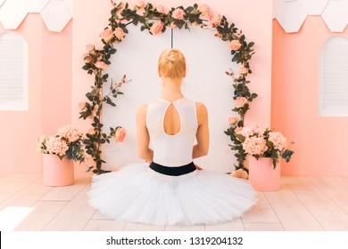 Tender sensual  young ballerina girl in white tutu . Concept of ballet dancer, dance and body