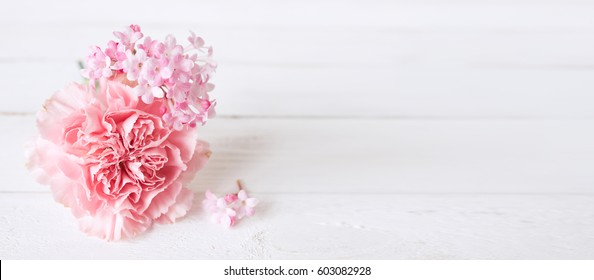 Tender still life with a pink carnation for mothers day or wedding in vintage style