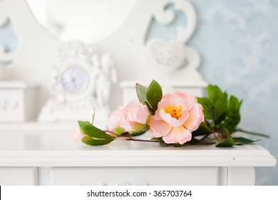 Tender tea rose on beautiful white dressing table
