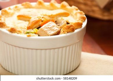 Tender Turkey with carrot, mushroom, peas, and corn inside of a flaky crust