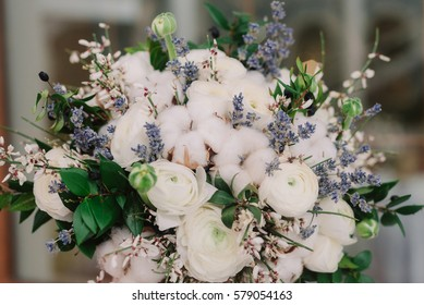 Tender wedding bouquet of roses, buttercup, lavender and cotton
