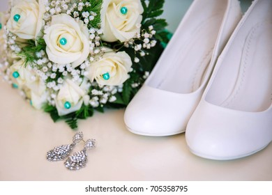 A tender wedding composition. A bouquet and shoes for the bride.