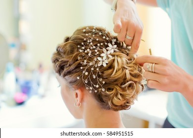 Tender wedding stylish hairstyle with accessories
