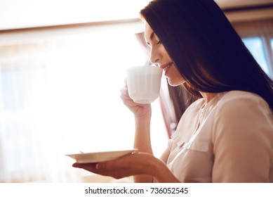 Tender woman drinking morning tea