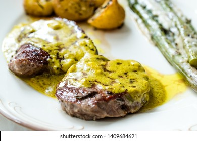 Tenderloin Meat with Cafe De Paris Sauce with Asparagus and Baked Potatoes in Plate Ready to Serve.