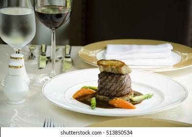 Tenderloin steak and Foie gras on black background.