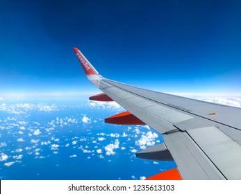 Tenerife, Canary Island, Spain - november 2018: Easyjet logo on airplane wing of Easyjet airplane flying over the atlantic ocean