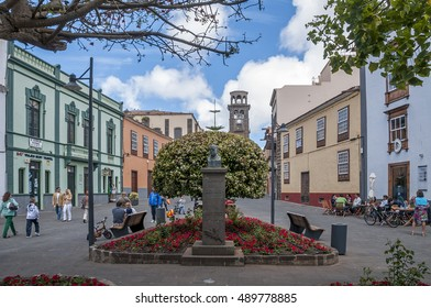 TENERIFE, CANARY ISLANDS - APRIL 04, 2012: Old houses and gardens, on the street Carrera, with the tower of the Conception in the background in the city of San Cristobal de La Laguna